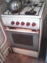 Продам газовую плиту б/у с работающей духовкой